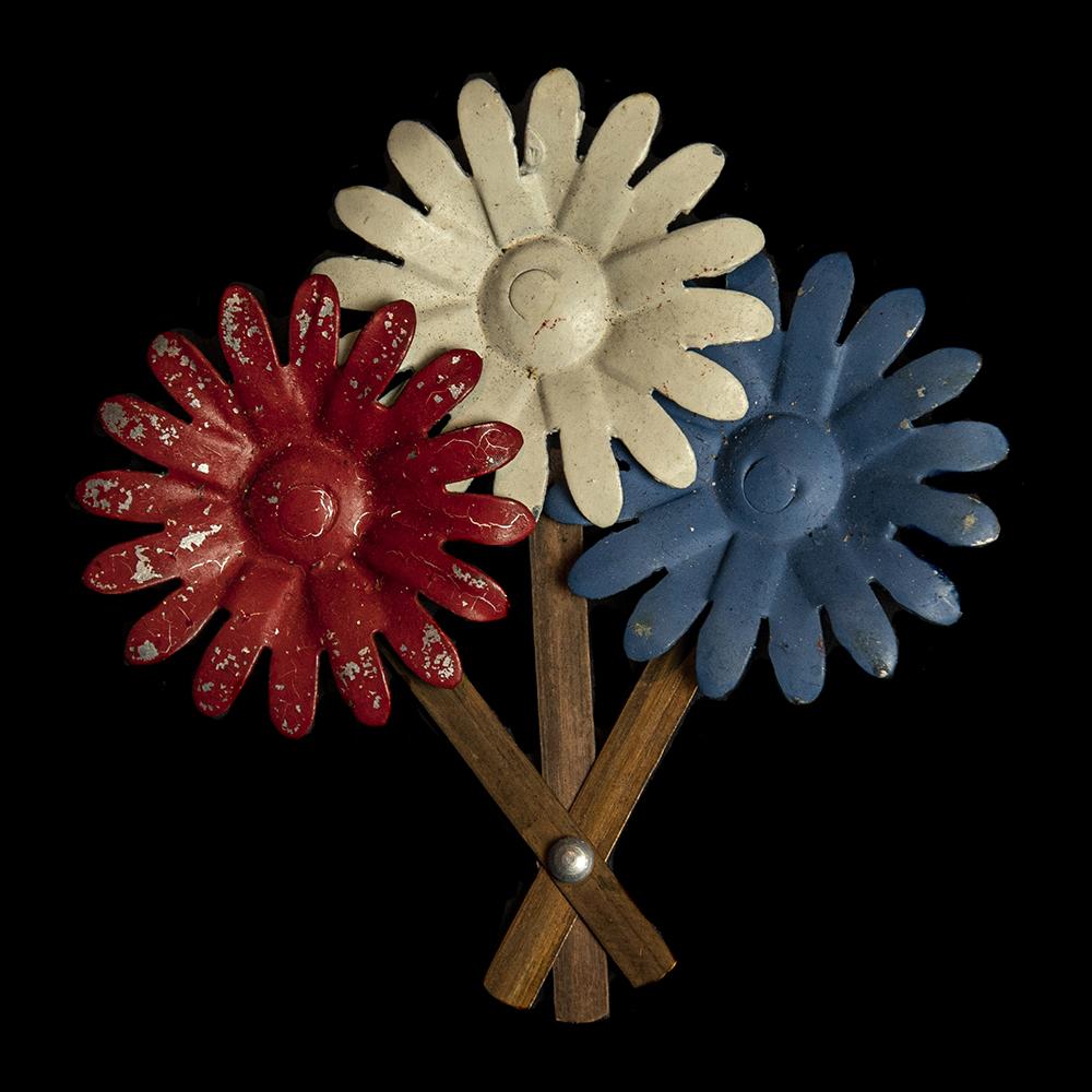 Bloemen speld Nederlandse vlag